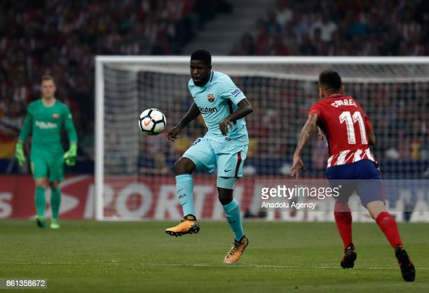 Samuel Umtiti of Barcelona in action against Angel Correa of Atletico Madrid during the Spanish La Liga match between Atletico Madrid and Barcelona...