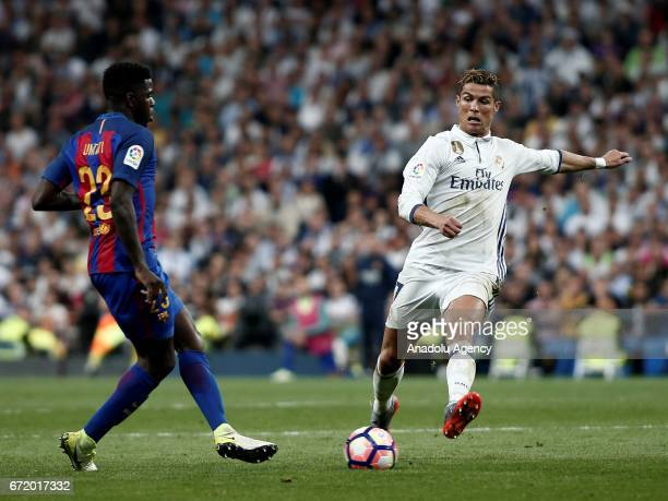 Samuel Umtiti of Barcelona in action against Cristiano Ronaldo of Real Madrid during the La Liga match between Real Madrid and Barcelona at Santiago...
