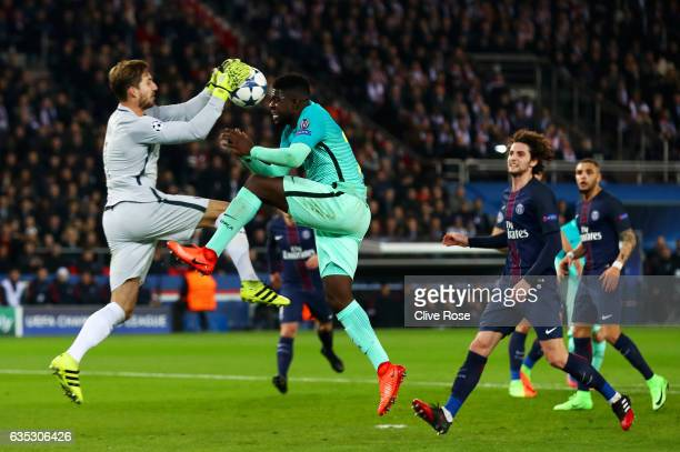 Samuel Umtiti of Barcelona jumps for the ball with Kevin Trapp of Paris SaintGermain during the UEFA Champions League Round of 16 first leg match...
