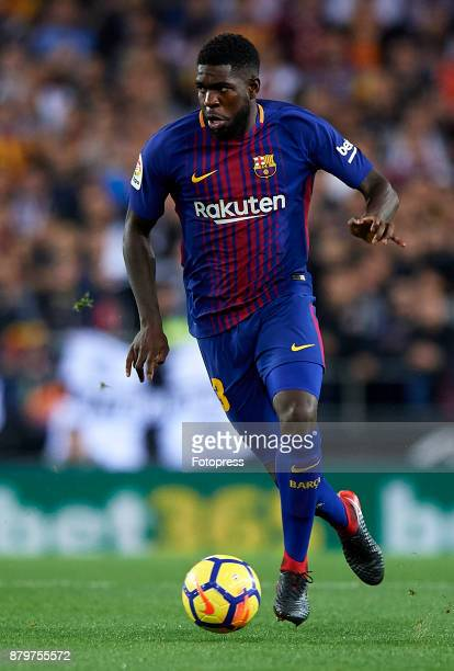 Samuel Umtiti of Barcelona runs with the ball during the La Liga match between Valencia and Barcelona at Estadio Mestalla on November 26 2017 in...