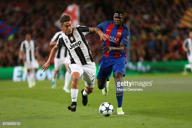 Samuel Umtiti of Fc Barcelona and Paulo Dybala of Juventus Fc battle for the ball during the UEFA Champions League quarter final Second leg match...