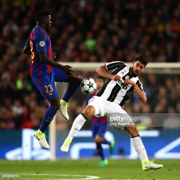 Samuel Umtiti of FC Barcelona and Sami Khedira of Juventus compete during the UEFA Champions League Quarter Final second leg match between FC...