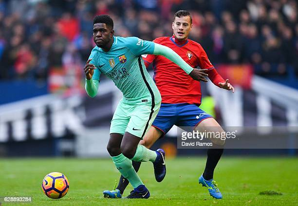 Samuel Umtiti of FC Barcelona competes for the ball with Oriol Riera of CA Osasuna during the La Liga match between CA Osasuna and FC Barcelona at...