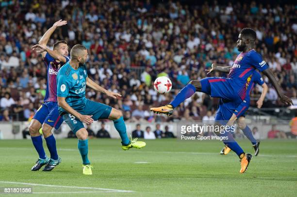 Samuel Umtiti of FC Barcelona fights for the ball with Karim Benzema of Real Madrid during the Supercopa de Espana Final 1st Leg match between FC...