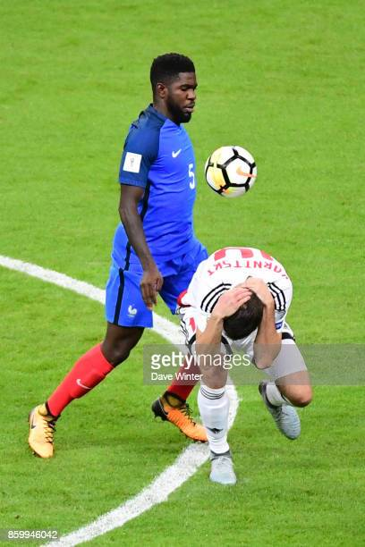 Samuel Umtiti of France and Alyaksandr Karnitsky of Belarus during the Fifa 2018 World Cup qualifying match between France and Belarus on October 10...