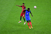 Samuel Umtiti of France and Nani of Portugal during the European Championship Final between Portugal and France at Stade de France on July 10 2016 in...