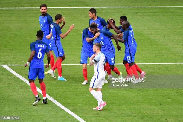 Samuel Umtiti of France celebrates after equalising during the International friendly match between France and England at Stade de France on June 13...