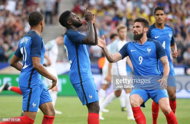 Samuel Umtiti of France celebrates his goal with Olivier Giroud during the international friendly match between France and England at Stade de France...