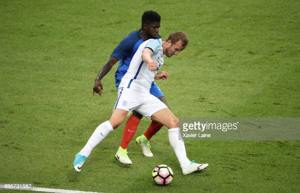 Samuel Umtiti of France in action with Harry Kane of England during the International Friendly match between France and England at Stade de France on...