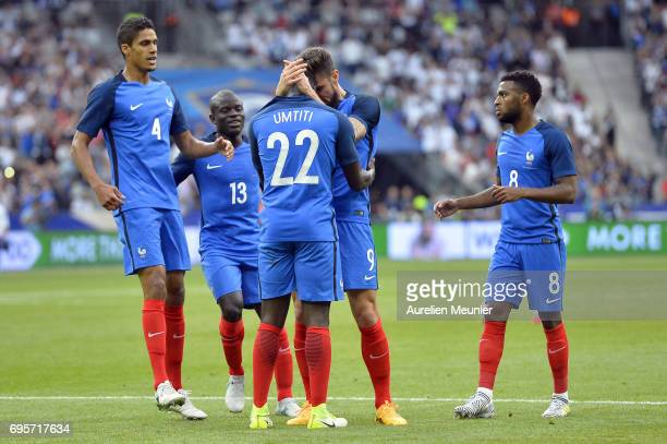 Samuel Umtiti of France is congratulated by teammate Olivier Giroud after scoring during the International friendly match between France and England...