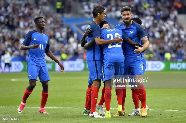 Samuel Umtiti of France is congratulated by teammates Olivier Giroud Raphael Varane and Ousmane Dembele after scoring during the International...