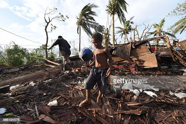 Samuel walk through through the ruins of his family home with his father Phillip on March 16 2015 in Port Vila Vanuatu Cyclone Pam has hit South...