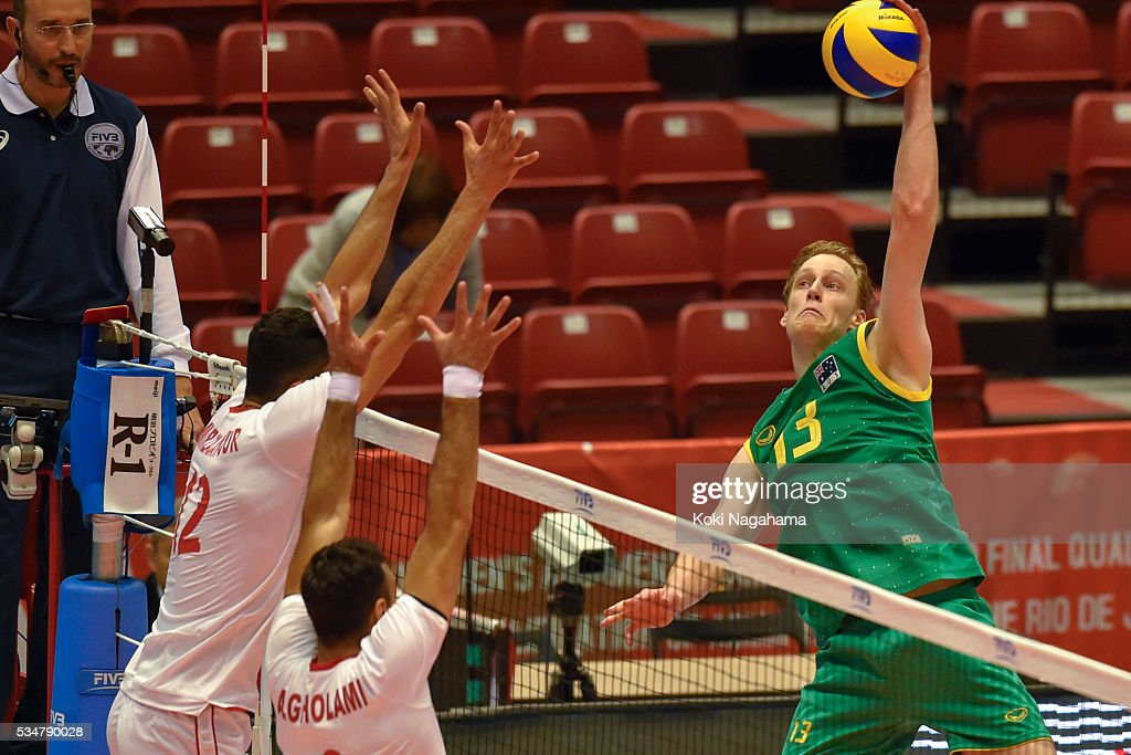 Samuel Walker #13of Australia spikes the ball during the Men's World Olympic Qualification game between Iran and Australia at Tokyo Metropolitan Gymnasium on May 28, 2016 in Tokyo, Japan.