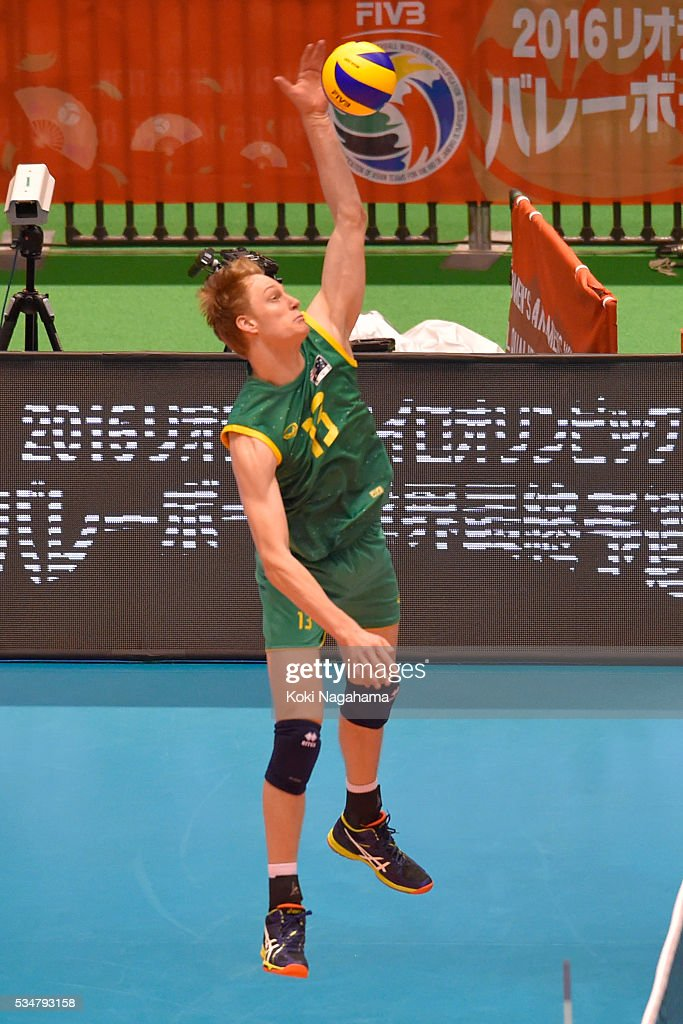 Samuel Walker #13 of Australia spikes the ball during the Men's World Olympic Qualification game between Iran and Australia at Tokyo Metropolitan Gymnasium on May 28, 2016 in Tokyo, Japan.