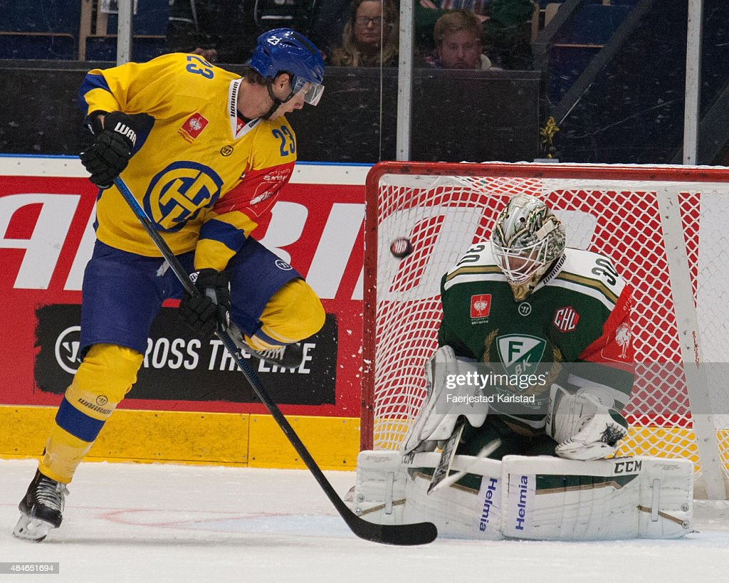 Samuel Walser of HC Davos and <a gi-track='captionPersonalityLinkClicked' href=/galleries/search?phrase=Lars+Haugen&family=editorial&specificpeople=7718894 ng-click='$event.stopPropagation()'>Lars Haugen</a> of Farjestad Karlstad during the Champions Hockey League group stage game between Farjestad Karlstad and HC Davos on August 20, 2015 in Karlstad, Sweden.
