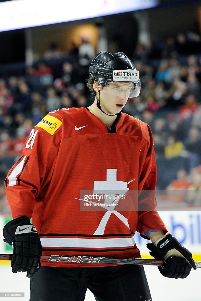 Samuel Walser #24 of Team Switzerland waits for a face-off during the 2012 World Junior Hockey Championship game against Team Denmark at the Saddledome on January 2, 2012 in Calgary, Alberta, Canada.