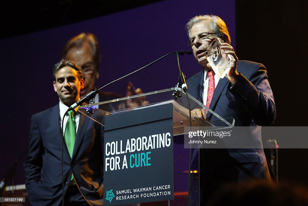 Samuel Waxman Cancer Research Foundation Chairman Michael Nierenberg and founder/CEO Dr. Samuel Waxman speak on stage during the 16th Annual Samuel Waxman Cancer Research Foundation Collaborating For A Cure Benefit Dinner & Auction at Park Avenue Armory on November 21, 2013 in New York City.