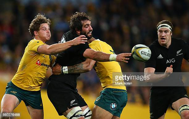 Samuel Whitelock of the All Blacks offloads during the Bledisloe Cup Rugby Championship match between the Australian Wallabies and the New Zealand...