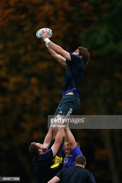 Samuel Whitelock of the All Blacks takes the ball in the lineout during a New Zealand All Blacks Captain's Run at Pennyhill Park on October 30 2015...