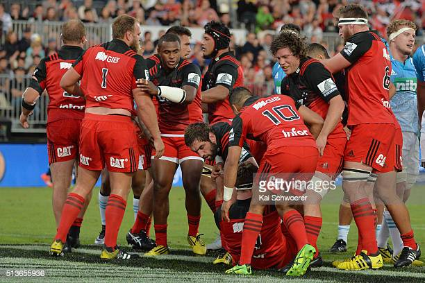 Samuel Whitelock of the Crusaders and his teammates celebrate scoring a penalty try during the round two Super Rugby match between the Crusaders and...