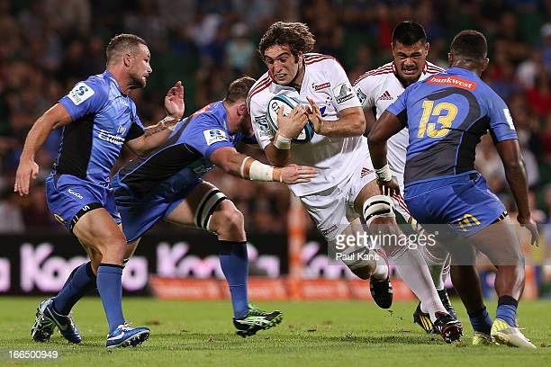 Samuel Whitelock of the Crusaders looks to avoid being tackled during the round 9 Super Rugby match between the Western Force and the Crusaders at...