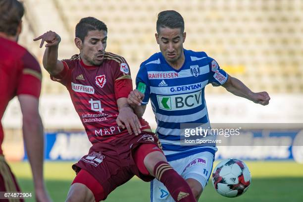 Samuele Campo vies with Gonzalo Zarate during the Swiss Super League match between FC LausanneSport and FC Vaduz at Stade Olympique de la Pontaise in...