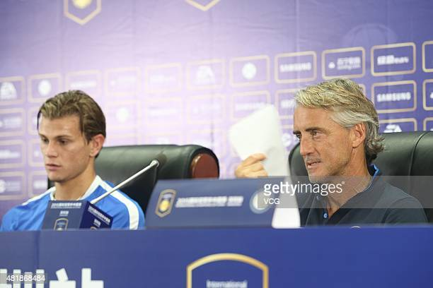 Samuele Longo and head coach Roberto Mancini of Inter Milan attend a press conference at Longgang Sports Center ahead of the International Champions...