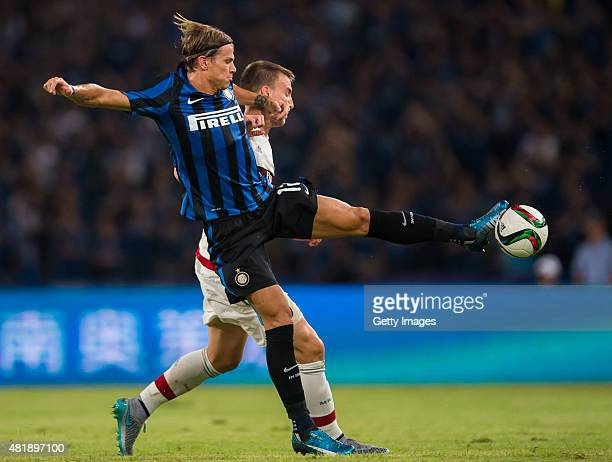 Samuele Longo of FC Internazionale Milano competes for the ball with Rodrigo Ely of AC Milan during the AC Milan vs FC Internacionale as part of the...