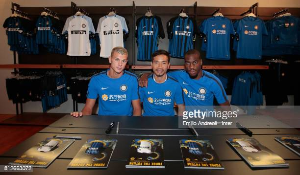 Samuele Longo Yuto Nagatomo and Geoffrey Kondogbia of FC Internazionale Milano visit the Inter Store prior to the FC Internazionale training session...