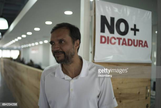 SamuelOlarte head organizer for Popular Will stands in front of a sign that reads 'No Dictatorship' at the organization's office in Caracas...