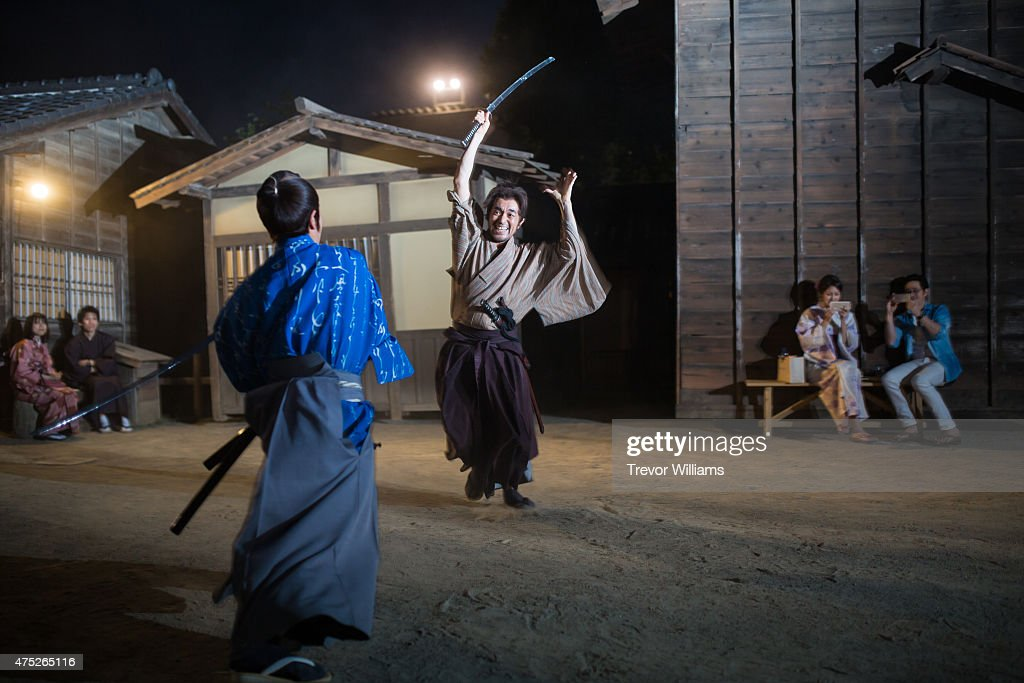 Samurai actors perform sword fights during the Uzumasa Edosakaba, an event recreating an edo-period bar at the Toei Kyoto Studio Park on May 30, 2015 in Kyoto, Japan. The Toei Kyoto Studio Park, a studio park built next to a working film set, turned itself into a big edo-period bar where people can drink and enjoy edo period culture including Japanese cuisine and samurai sword fighting.