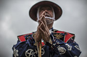 A samurai horseman clasps his hands in a ceremony during the Soma Nomaoi festival at Hibarigahara field in Minamisoma Fukushima Prefecture Japan on...