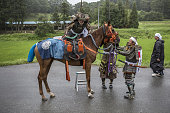 A samurai horseman mounts his horse ahead of the Soma Nomaoi festival in Minamisoma Fukushima Prefecture Japan on Sunday July 24 2016 Every July...