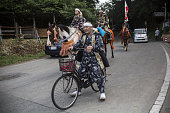 A samurai horseman rides a bicycle from the Soma Nomaoi festival in Minamisoma Fukushima Prefecture Japan on Sunday July 24 2016 Every July hundreds...