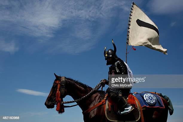 A samurai horseman waits to take part in the Kacchukeiba during the Soma Nomaoi festival at Hibarigahara field on July 26 2015 in Minamisoma Japan...