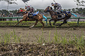 Samurai horsemen compete in the Kachu Keiba race during the Soma Nomaoi festival at Hibarigahara field in Minamisoma Fukushima Prefecture Japan on...