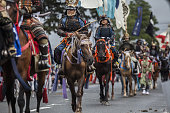 Samurai horsemen make their way through a street during the Soma Nomaoi festival in Minamisoma Fukushima Prefecture Japan on Sunday July 24 2016...