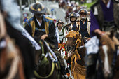 Samurai horsemen make their way through a street in a procession during the Soma Nomaoi festival in Soma Fukushima Prefecture Japan on Saturday July...