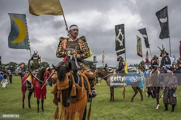 Samurai horsemen participate in a ceremony during the Soma Nomaoi festival at Hibarigahara field in Minamisoma Fukushima Prefecture Japan on Sunday...