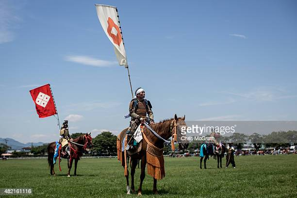 Samurai horsemen wait to to compete during the Soma Nomaoi festival at Hibarigahara field on July 26 2015 in Minamisoma Japan Every summer the people...