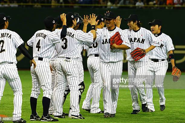 Samurai Japan celebrate after winning the game three of Samurai Japan and MLB All Stars at Tokyo Dome on November 15 2014 in Tokyo Japan
