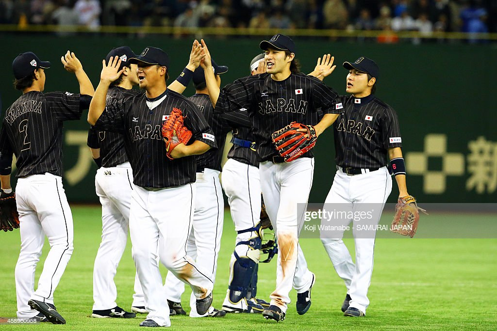 Samurai Japan members celebrate after winning the game two of Samurai Japan and MLB All Stars at Tokyo Dome on November 14, 2014 in Tokyo, Japan.