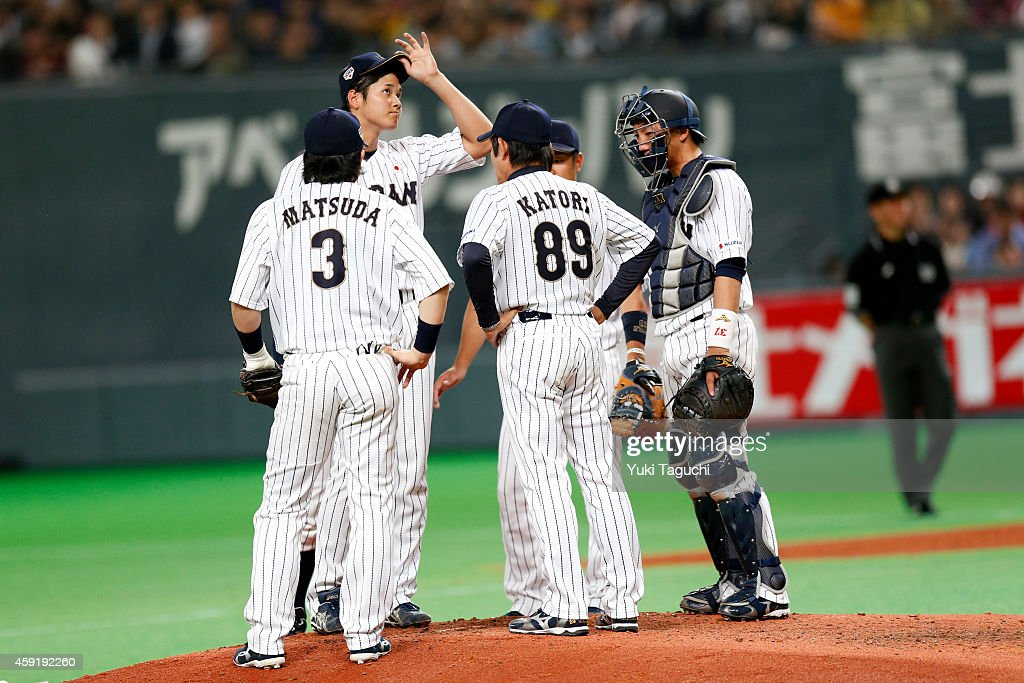 Samurai Japan pitching coach Yoshitaka Katori visits the mound during the game against the MLB AllStars at the Sapporo Dome during the Japan AllStar...