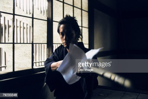 Samurai warrior cleaning a sword : Stock Photo