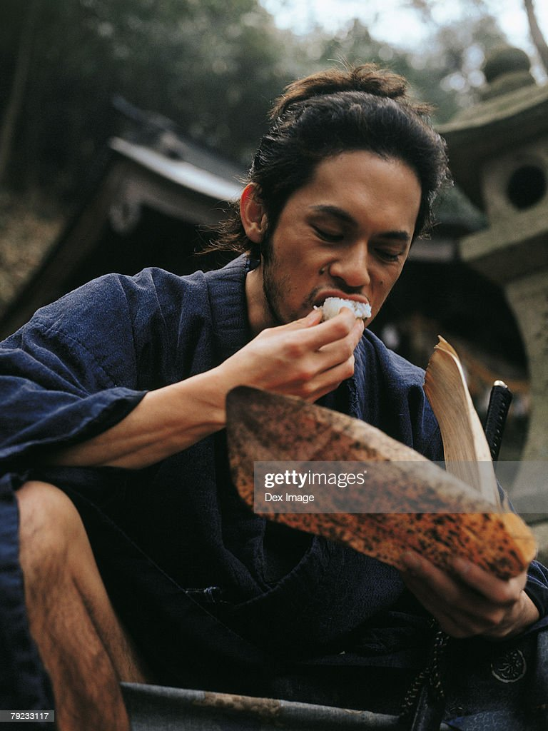 Samurai warrior eating food : Stock Photo