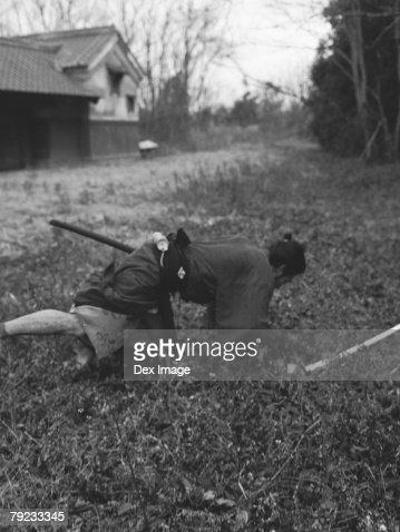 Samurai warrior falling to the ground : Stock Photo