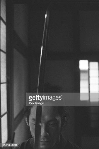 Samurai warrior holding a sword : Stock Photo