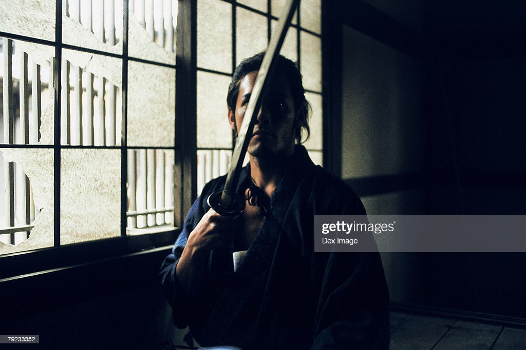Samurai warrior holding a sword : Stock Photo