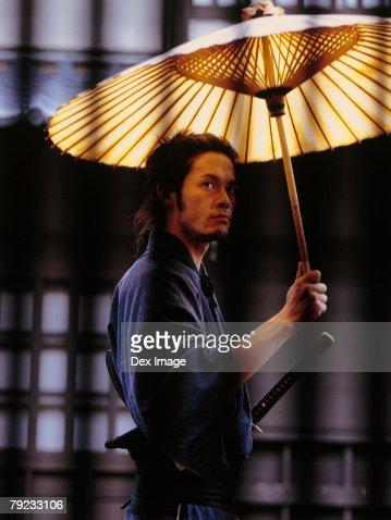 Samurai warrior holding an umbrella : Stock Photo