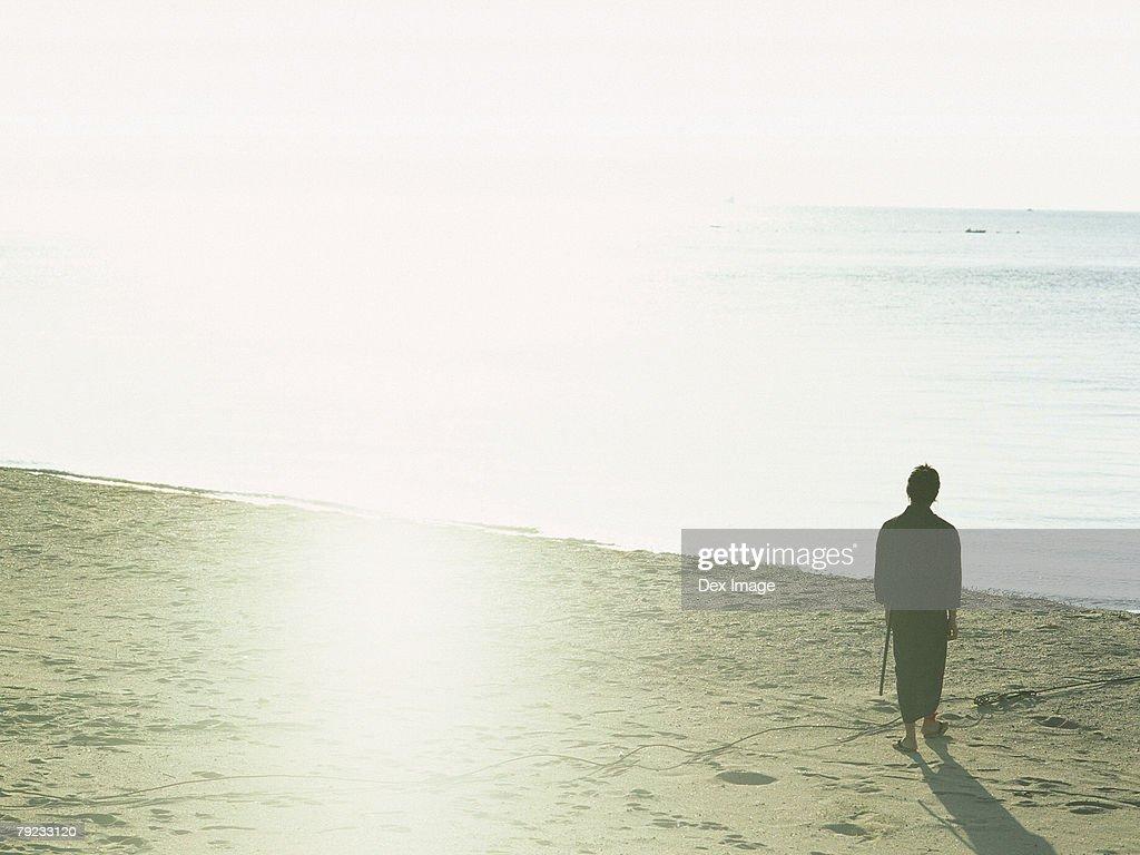 Samurai warrior standing at the beach : Stock Photo